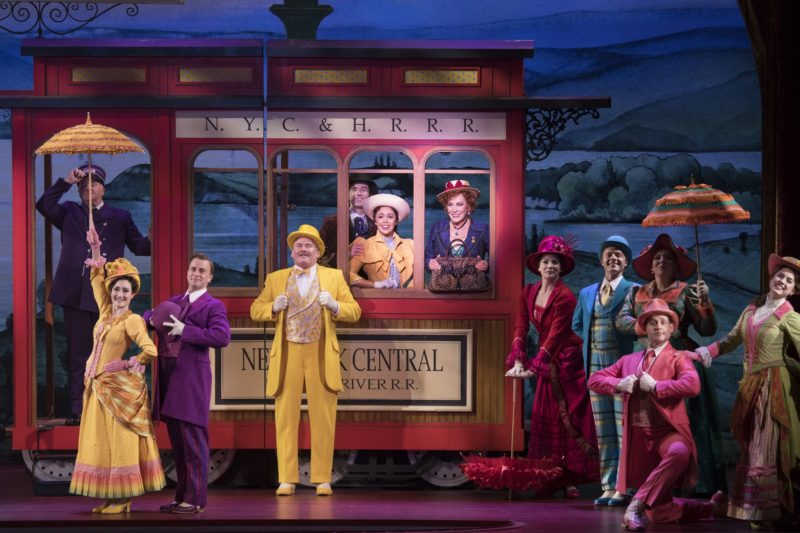 "Cornelius, Barnaby, Ambrose, Ermengarde and Dolly board the train to New York in the musical number ""Put On Your Sunday Clothes""."