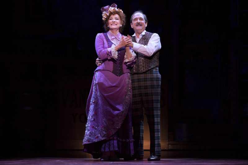 Lewis J. Stadlen as Horace and Betty Buckley as Dolly hold each other as they sing together.
