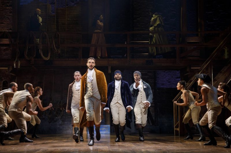 Firends Alexander Hamilton, Aaron Burr, John Laurens, the Marquis de Lafayette and Hercules Mulligan walk downstage through the crowd, determined to help the revolution.